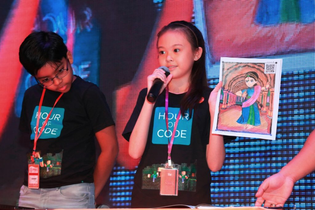 KidZania CongreZZ member Alysha Chin Jia Qi, 11, from SK Taman Megah demonstrating about Augmented Reality at the KidZ & Tech launch recently using a picture she coloured herself