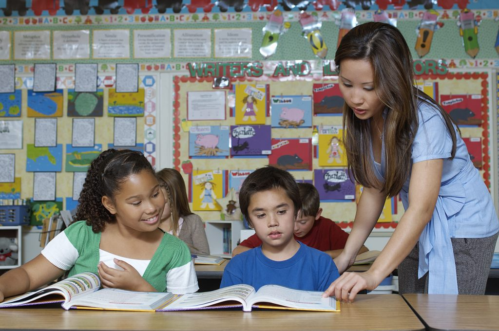 Teacher and pupils in classroom